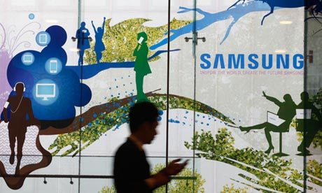 A man walks past a Samsung advertisement in Seoul, South Korea